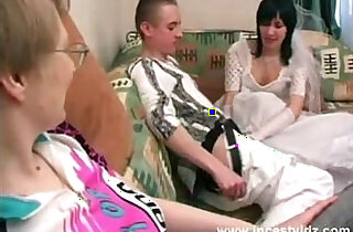 Mother, son and horny daughter in wedding dress in action