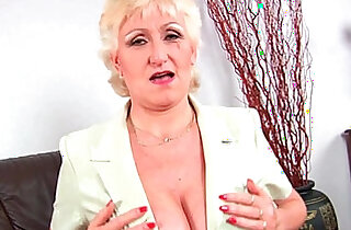 Granny Anna with her big tits finger fucks her sweet pussy