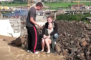 Public fuck of a cute teen blonde girl by guys at a construction site