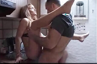 Mother daughter fucked in the kitchen